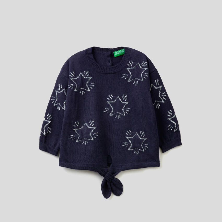 Sweater with inlaid stars and bow