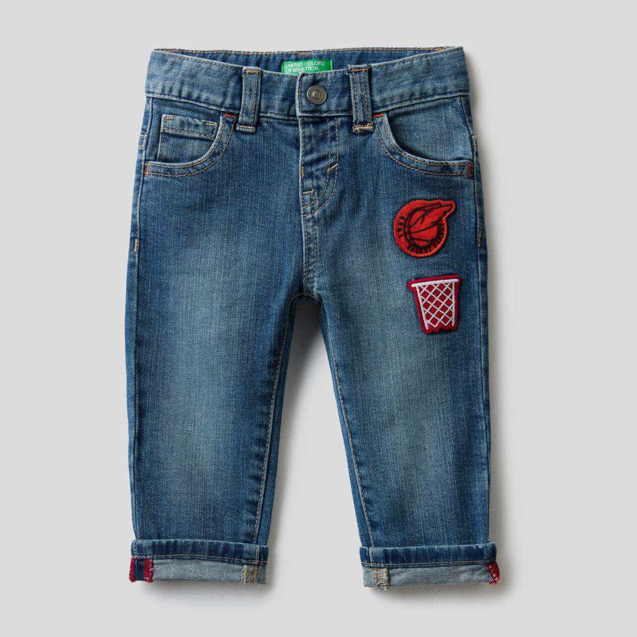 Five pocket jeans with patches