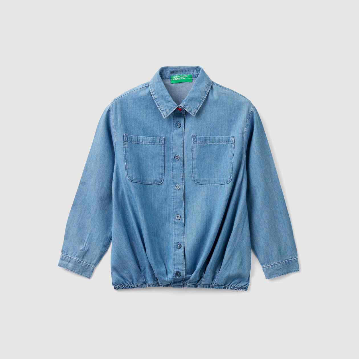 Shirt with elastic at the bottom